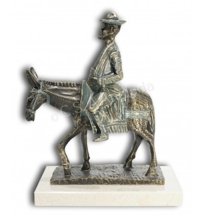 Realistic character sculpture Sancho Panza on a donkey